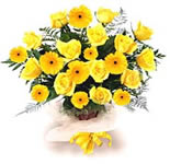 Bright yellow roses with lovely golden and green fillers oozing out with energy, in a hand tiedarrangement. Send these 30 stems of energy to the one who is so closed to your heart.