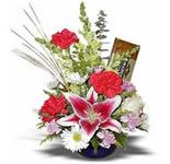 Medium size arrangement includes: Star Gazer Lily, Carnations, Daisies, Two roses and assorted greenery. Sweet gift good for any occasion and any time.... Bar of chocolate makes it even more enjoyable.