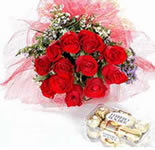 Send this hand tied bouquet of 12 Roses with this mouth watering 16 Pcs. Of Hazelnut Fererro Rocher Chocoaltes to celebrate any occasion.
